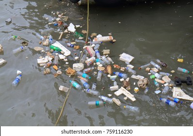 MUMBAI INDIA - NOVEMBER 11, 2017: Rubbish floating in the ocean in Mumbai.