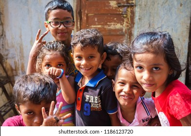 Mumbai, India - November 14, 2016: Happy smiling poor children from Banganga slum in Mumbai, India