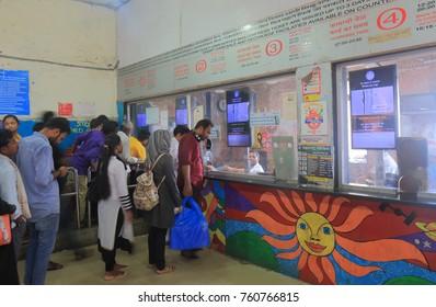 MUMBAI INDIA - NOVEMBER 14, 2017: Unidentified people buy train tickets at Sandhurst Road train station in downtown Mumbai.