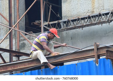 MUMBAI INDIA - NOVEMBER 14, 2017: Unidentified man works at construction site in downtown Mumbai.