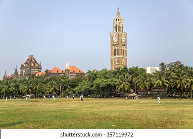 MUMBAI, INDIA - OCTOBER 10, 2015: Unidentified people playing sqiash by the Rajabai Clock Tower in Mumbai. Tower was completed at 1878 and have height of 85 m.