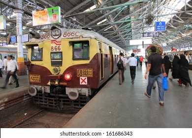 MUMBAI, INDIA - October 26, 2011: Commuters at Chhatrapati Shivaji Terminus on November 21, 2012 in Mumbai, India. Every day about 3 to 4 millions passengers pass through the station.
