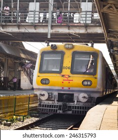 MUMBAI, INDIA - SEPTEMBER 12: Suberban train pulling on Mumbai Central station on September 12, 2013 in Mumbai, India. Mumbai Suburban Railway carries more than 7 million commuters on a daily basis.