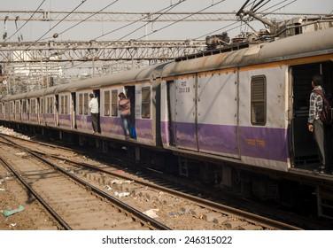 MUMBAI, INDIA - SEPTEMBER 12: Unidentified commuters traveling via Suburban train on September 12, 2013 in Mumbai, India. Mumbai Suburban Railway carries more than 7 million commuters on a daily basis