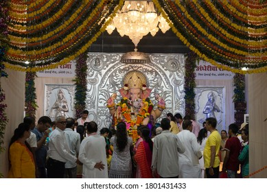 Mumbai, India - September 23, 2018 : Devotees praying chanting Lord Ganesh idol in temple to be immersed in the Arabian sea during Hindu  Ganesha chaturathi festival