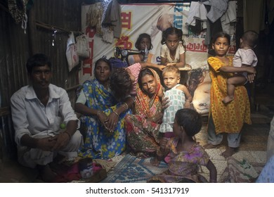 Mumbai / India16 September 2009 Family with sewing machine in Malvani slum   Malad Bombay , Mumbai , Maharashtra , India