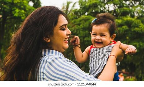 Mumbai, Maharashtra - 6-10-2018: A girl playing with a toddler