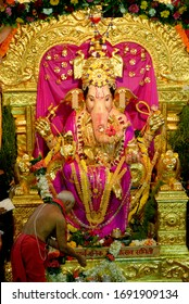 Mumbai; Maharashtra; Asia; India - Sep. 03; 2009 - Preist Performing Pooja at G. S. B. Ganesha Ganapati Festival Elephant Headed Hindu God Wadala