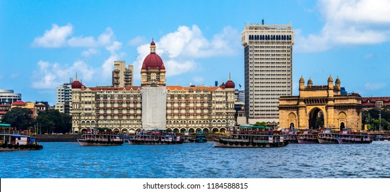 Mumbai, Maharashtra / India - 09/12/2018: Three famous monuments in a single photo. The old Taj Hotel building, the new Taj Hotel building and the Gateway of India on the banks of Arabian Sea.