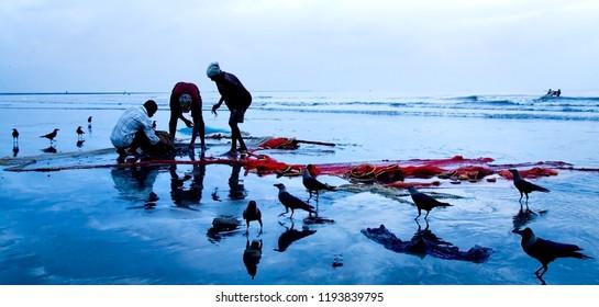 Mumbai, Maharashtra, India - 13 Sep 2007: days pick - day starts at Juhu beach in Mumbai. Life of fishermen on the beach