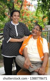 Mumbai; Maharashtra; India- 19th May, 2013  : Nature lover Indian Old age happy couple