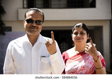 MUMBAI, MAHARASHTRA, INDIA 21 FEBRUARY 2017 : Unidentified people show their ink-marked fingers after casting their votes in front of polling booth of the area.