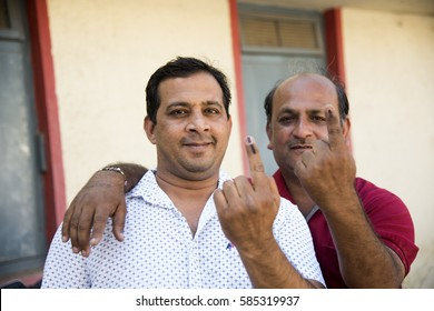 MUMBAI, MAHARASHTRA, INDIA 21 FEBRUARY 2017 : Unidentified people show their ink-marked fingers after casting votes in front of polling booth of the area.
