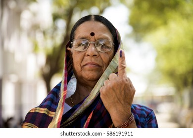 MUMBAI, MAHARASHTRA, INDIA 21 FEBRUARY 2017 : Unidentified Indian people show their ink-marked fingers after casting votes in front of polling booth of the area.