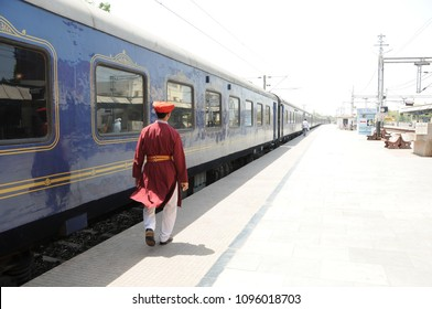 MUMBAI, MAHARASHTRA, INDIA 21 MARCH 2015 : Deccan Odyssey luxurious train with passenger at railway station. Deccan Odyssey train providing a luxury travel experience magnificent history of India.