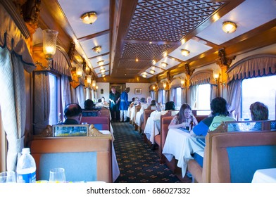 MUMBAI, MAHARASHTRA, INDIA 21 MARCH 2015 : Unidentified tourist on board the Deccan Odyssey luxurious passenger train, providing a luxury travel experience magnificent history of India.