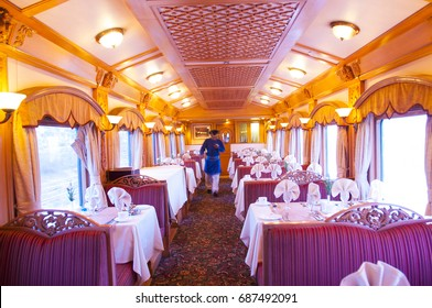 MUMBAI, MAHARASHTRA, INDIA 21 MARCH 2015 : Attendants of the Deccan Odyssey luxurious passenger train. Deccan Odyssey train providing a luxury travel experience magnificent history of India.