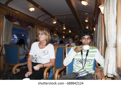 MUMBAI, MAHARASHTRA, INDIA 21 MARCH 2015 : Unidentified tourists on board the Deccan Odyssey luxurious passenger train. providing a luxury travel experience of the magnificent history of India.
