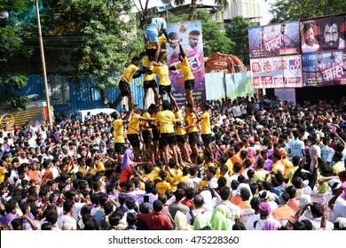 """MUMBAI, MAHARASHTRA, INDIA - 25 AUGUST 2016 : Crowd of young People """"Govinda"""" enjoying the Dahi Handi festival to celebrate God Krishna's Birth in Mumbai, Maharashtra, India. 25 August 2016."""