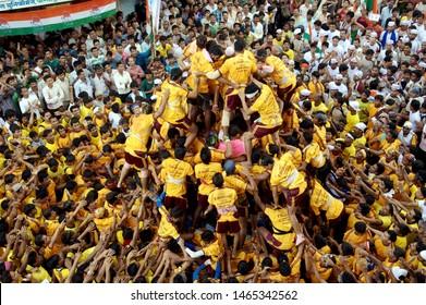 Mumbai Maharashtra India, Asia - Aug, 2011 : Human Pyramid trying to break dahi handi on Janmashtami, Gokulashtami Govinda Hindu Festival to celebrate Lord Krishna's birthday