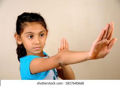 Mumbai, Maharashtra, India- Asia, Dec. 29, 2014 - Indian cute little  girl Female boxer in a self-defense posture.