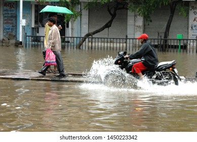 Mumbai; Maharashtra; India- Asia; July; 2006 : Blurred image People walking through water logging flooded street during heavy rains in Parel Mumbai