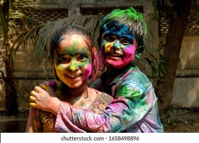 Mumbai; Maharashtra; India- Asia; March. 11; 2009 - Festival of colors Young friends and family celebrating enjoying traditional famous holi festival