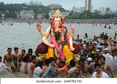Mumbai, Maharashtra, India- Asia, Sep. 2005 : Ganesh idol carried to the sea water at the beach for immersion. Last day of the Ganesh Festival celebration in Mumbai
