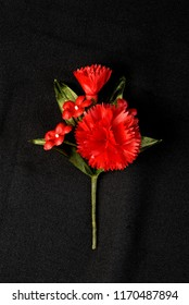 Mumbai Maharashtra India August 25 2007 Btton hole for bestman used in christian wedding name of flowers carnation made in sateen cloth by hand