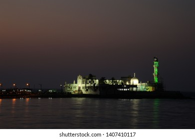 Mumbai; Maharashtra; India- Feb. 2015 : Haji Ali Dargah is a mosque and dargah or the monument of Pir Haji Ali Shah Bukhari located on an islet off the coast of Worli in the southern part of Mumbai.