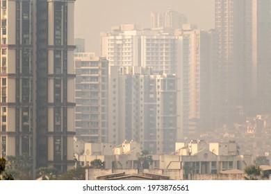 Mumbai, Maharashtra, India - January 2021: A hazy skyline of suburban Mumbai with a highrise skyscrapers in a dense, congested neighbourhood.