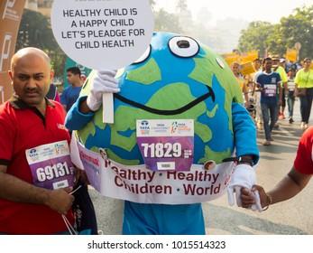 Mumbai, Maharashtra / India - January 21 2018: Man wearing earth dress to display cause in mumbai marathon event