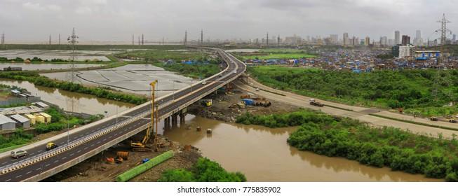 Mumbai, Maharashtra, India, ,June, 8,2013: Freeway tollfree flyover long stretch concrete elevated  bridge connecting Chembur suburb to Mumbai  main city