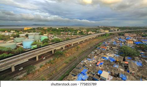 Mumbai, Maharashtra, India, ,June, 8,2013: Freeway tollfree flyover long stretch elevated  concrete bridge connecting Chembur suburb to Mumbai  main city