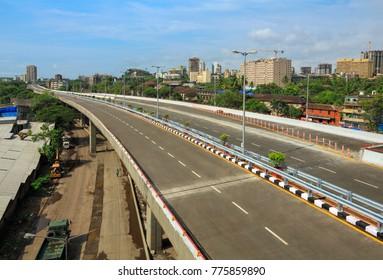 Mumbai, Maharashtra, India, ,June, 8,2013: Freeway tollfree flyover long stretch concrete bridge connecting Chembur suburb to Mumbai main city