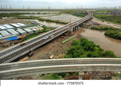 Mumbai, Maharashtra, India, ,June, 8,2013: Freeway tollfree flyover long stretch  elevated  concrete bridge connecting Chembur suburb to Mumbai main city also seen monorail  track in foreground .