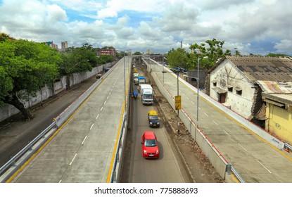 Mumbai, Maharashtra, India, ,June, 8,2013: Aerial view of freeway tollfree flyover long stretch  elevated concrete bridge connecting Chembur suburb to Mumbai main city ending here