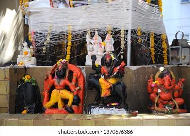 Mumbai, Maharashtra, India - March, 2013 : Place of worship Idol of hindu God and Godess  illegal temple in mumbai Lord Shiva, Goddess Kali & Lord Ganesh