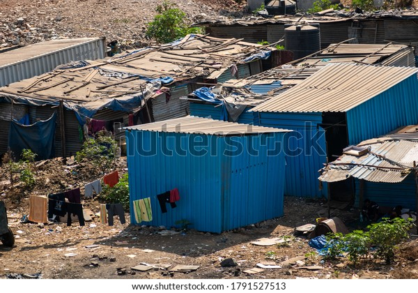 Mumbai, Maharashtra, India - March 2020: Corrugated metal shacks of a slum around a construction site in the city of Mumbai.