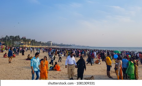 Mumbai, Maharashtra / India - March 25 2018: People came to watch a beautiful evening at Juhu Beach with their families