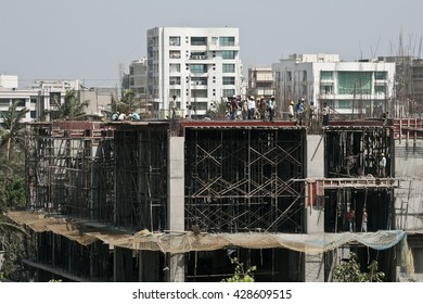 MUMBAI, MAHARASHTRA / INDIA - MARCH 27, 2009 : WORKERS ARE WORKING ON THE CONSTRUCTION SITE.