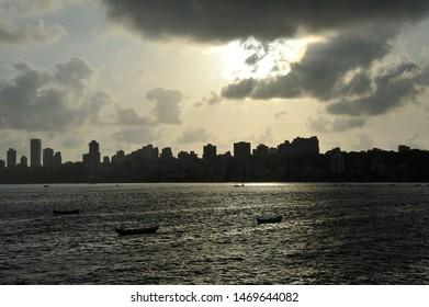 Mumbai; Maharashtra; India- May; 2012 : Beautiful Skyline showing Walkeshwar area at sunset from marine drive in Mumbai,