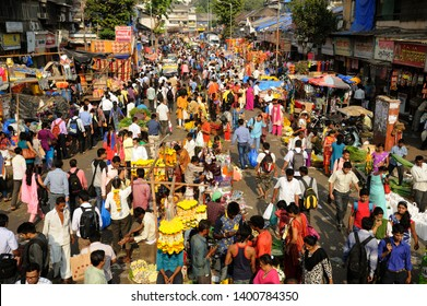 Mumbai; Maharashtra; India - Nov.; 2015: Dadar Market; Huge Crowd and row of Hawkers People buy Garlands on Ganesh Ganpati festival  Bombay