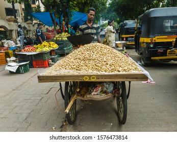 Mumbai, Maharashtra, India - November 2019: A pile  of groundnuts on a cart in the streets of the suburb of Kandivali.