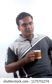 Mumbai Maharashtra India October 28 2008 Young man drinking tea or coffi from mug