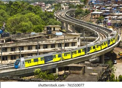 Mumbai Maharashtra India-june 29,2014: Suburban Metro train turningon S curve connecting Ghatkopar and Versova,Mumbai,Bombay,Maharashtra