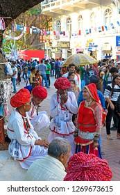 """Mumbai, Maharashtra/India - February 8th, 2017: Kala Ghoda Festival, Group Of Rajashtani Men And A Woman Talking With Each Other"