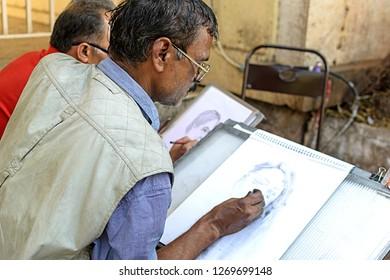 """""""Mumbai, Maharashtra/India - February 8th, 2017: An Artist Sketching At The Kala Ghoda Festival"""