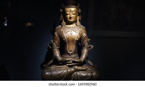 Mumbai, Maharastra/India- April 07 2020: Brass statue of the hindu god- Agni.