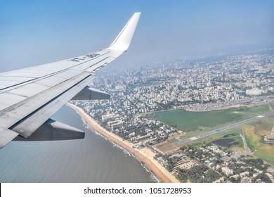 Mumbai- March 2018: Beautiful view of the city  and Juhu beach from airplane window.